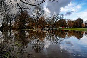 Floods by the cricket pitch at Poole Park, Poole. Dorset