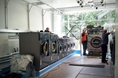 Moving in new washing machines and tumble driers. Barker Dry Cleaning and Laundry, Lower Parkstone.