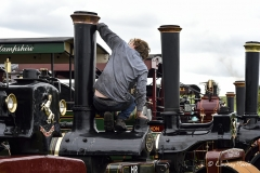 Cleaning a steam engine at the Great Dorset Steam Fair 2017.