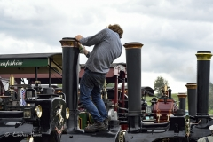 Polishing a steam engine at the Great Dorset Steam Fair 2017.