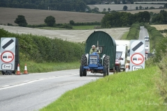 Steam tractor pulls a shepherd's hut en route to the Great Dorset Steam Fair (aka The National Heritage Show) at Tarrant Hinton, Dorset.