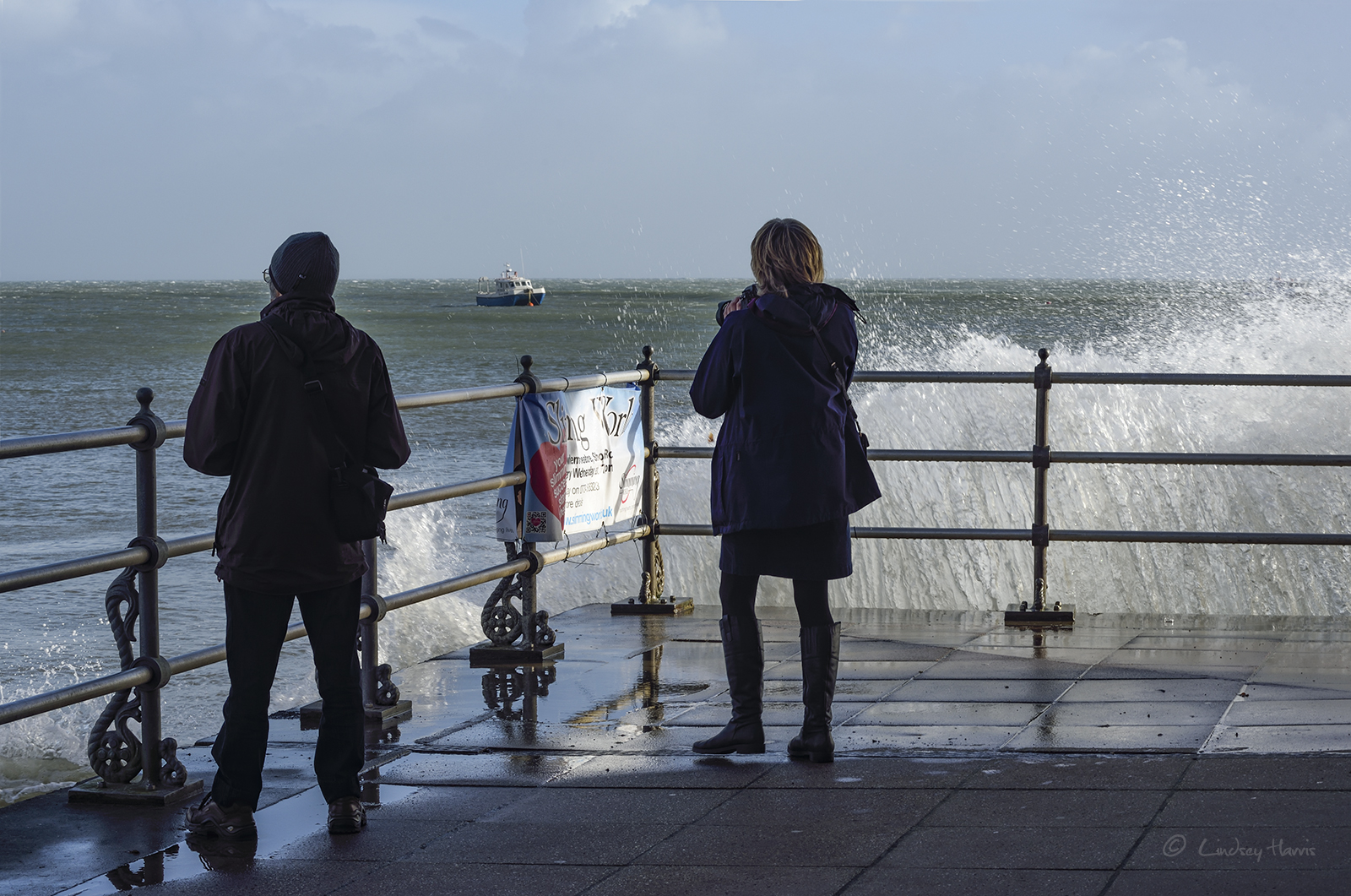 Photographers by the Mowlem Theatre, Swanage, during Storm Brian, 21st October 2017.