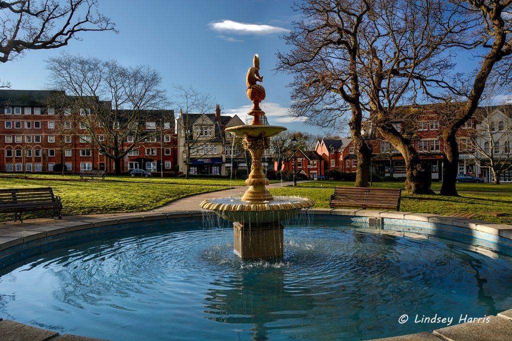 Fountain in spring sunshine at The Green, Parkstone Park, Ashley Cross, Lower Parkstone.