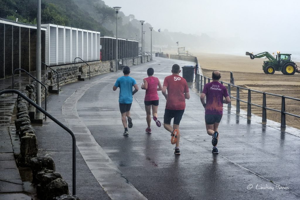 Runners in the rain near Flaghead beach, Poole - 2nd August 2017