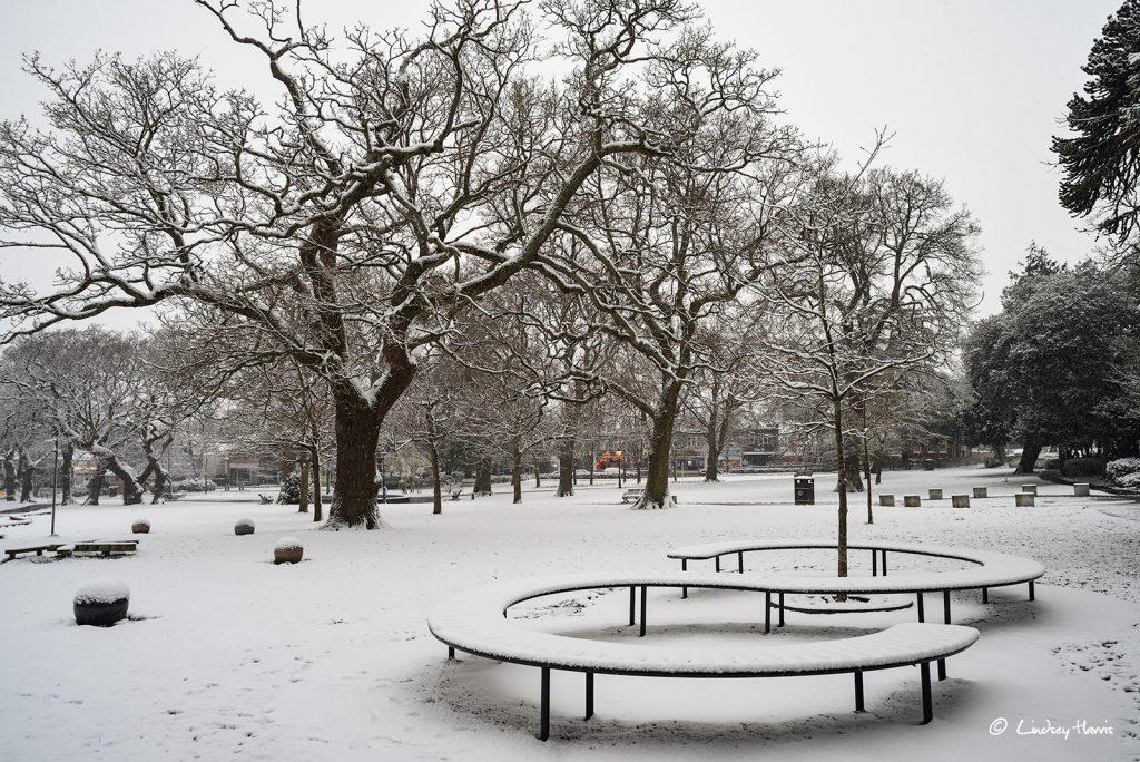 A snowy Parkstone Park, Ashley Cross, Lower Parkstone, Poole. 18th March 2018.