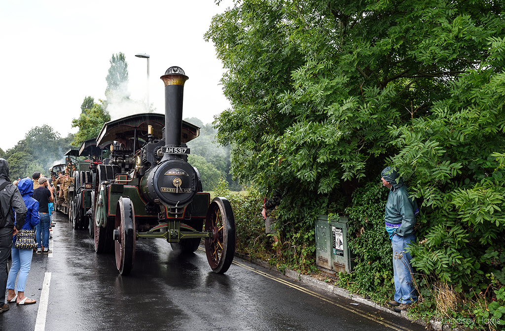 Vehicles and traction engines from the WW1 Homecoming Parade arriving in the rain at Blandford Forum, Dorset.