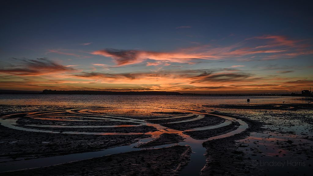Stunning sunset and circles in the sand, Poole Harbour. Dorset.
