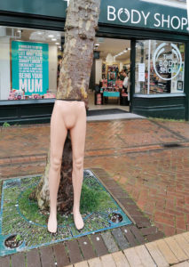 Mannequin legs in Bournemouth outside The Body Shop.