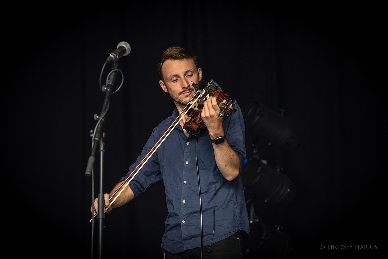 Violin player from Jim Ghedi's band.