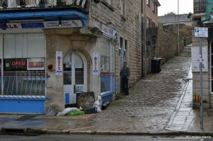 Sandbagging against the floods in High Street, Swanage
