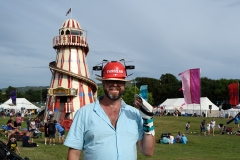 Man with Thirst Aid hat and a (co-incidentally) damaged hand at Camp Bestival 2019.