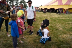 Chimp and children at Camp Bestival.