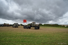 Commercial vehicles going to the Heavy Haulage Arena, under a stormy sky.