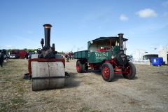 Steam roller and steam lorry.