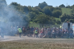 A crowd gathers to watch a hedge fire at 'Watford Gap'. near the main arena of the Great Dorset Steam Fair.