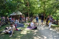 Crowds take refuge in from the fierce sun at Larmer Tree Festival 2018.