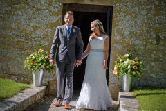 A couple get married at the Church of St. Nicholas of Myra, Worth Matravers, on 1st August 2015.