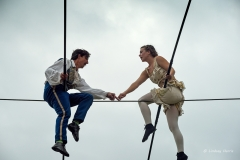 Chris and Phoebe Bullzini sitting astride the tightrope.
